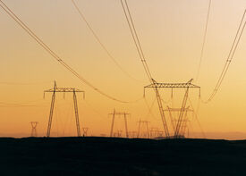 Overhead lines at Hellisheiði during sunset.